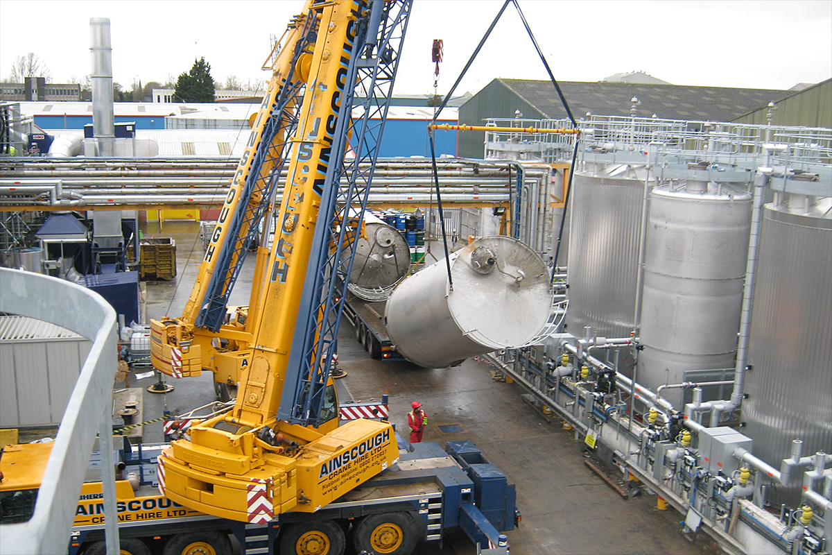 Raw material bulk storage vessel installation during manufacturing plant construction project