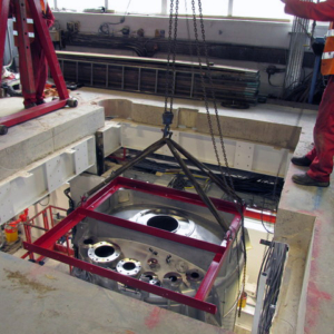 """Mixer lowered into position. Note the mixer is sat between two floors. The top floor is for operator access and the bottom is for let down. It was a challenge to cut through the 12"""" concrete floor (including all necessary support) in preparation for the mixer."""