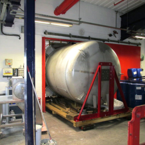 10,000 litre mixer on skates, travelled up an elevator and through the door to gain access to the production facility and its final location.