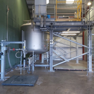 10,000-litre blending vessel installed with all associated infrastructure. To the left is an IBC weight scale