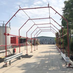 Sprinkler system pipework for road tanker loading area painted red